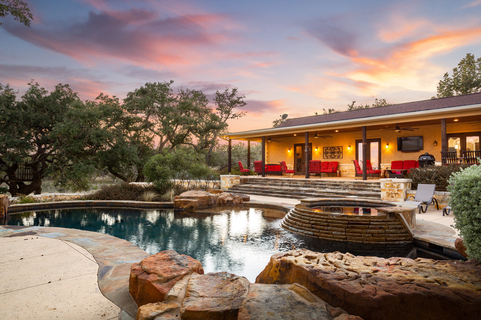 Luxurious outdoor living and pool space in the Texas hill country near Boerne, Texas